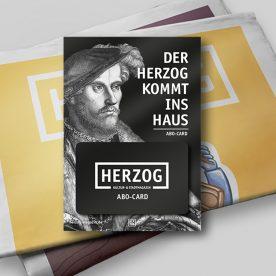 HERZOG Jahresabo Karte vor HERZOG Zeitungen